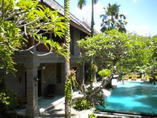 Taman Suci Suite & Villas Balis - Didelis kambarys