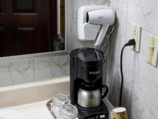 Airport Hotel Costa Rica San Jose - Hairdryer in room and coffee maker