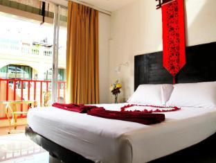 Boomerang Inn Phuket - Gästezimmer