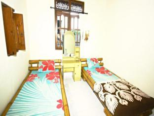 Yuliati House Bali - Istaba viesiem