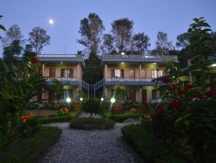Chitwan Village Resort Chitwan National Park - Hotel in the evening