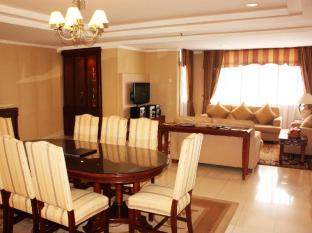 Travellers Suites Serviced Apartments Medan - सुइट कक्ष