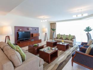 JA Oasis Beach Tower Apartments Dubai - 4 Bedroom Living Room