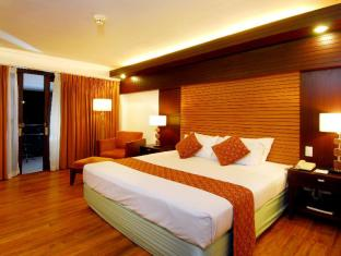 Waterfront Airport Hotel and Casino Mactan Mactan-saari - Hotellihuone