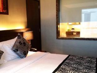 Peninsula Excelsior Hotel Singapur - Habitación