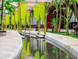 The Mansion Resort Hotel & Spa Bali - Tuin