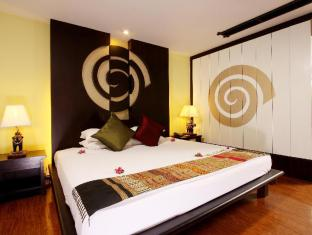 Andaman Cannacia Resort & Spa Phuket - Hotellihuone