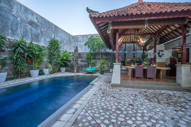 traditional balinese villa with big swimming pool