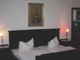 Hotel Pension Columbus Berliin - Külalistetuba