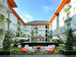 HARRIS Hotel & Residences Riverview Kuta Bali - Main Swimming Pool and Garden Area