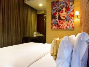 Nostalgia Hotel Singapur - Pokoj pro hosty