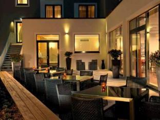 أدينا للشقق الفندقية برلين هاوبتباهنهوف برلين - المطعم