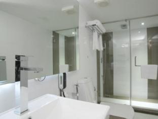 The Spring Hotel Chennai - Bathroom