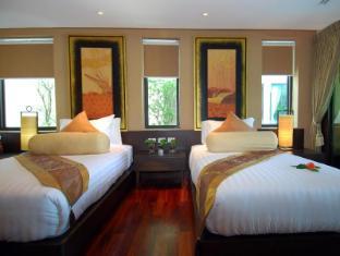 Niramaya Villa & Wellness Resort פוקט - חדר שינה