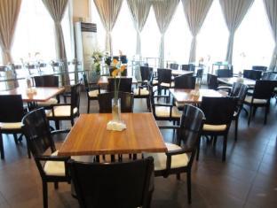 索托格蘭德酒店和度假村 麥克坦島 - 餐廳