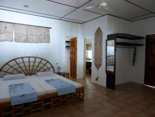 Marcosas Cottages Resort Moalboal - חדר שינה