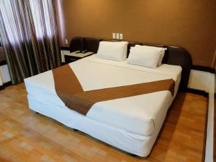 Holiday Spa Hotel Cebu City - Gästrum
