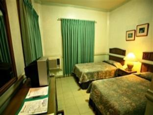 Villa Margarita Hotel Davao City - חדר שינה