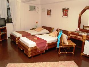 Charts Resort & Art Cafe Panglao Island - חדר שינה