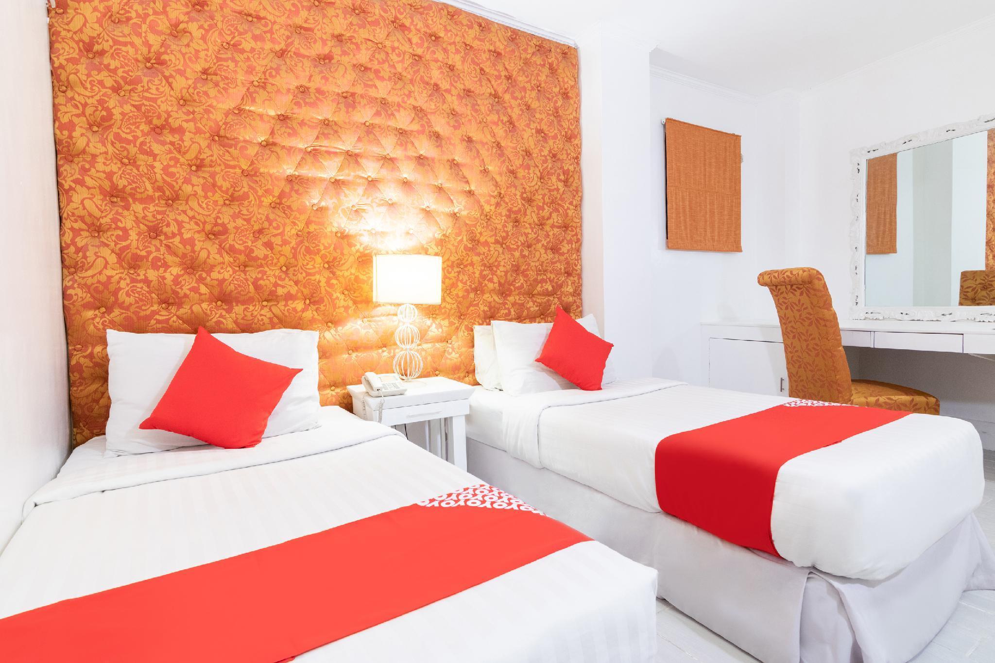 OYO 185 Seven Suites Hotel