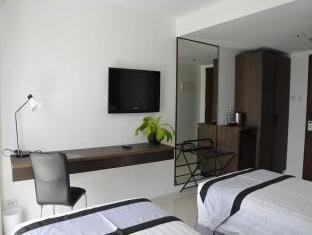 Cityscape Hotel Mandaue City - חדר שינה