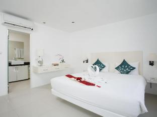 Grand Sunset Hotel Phuket - Kamar Tidur
