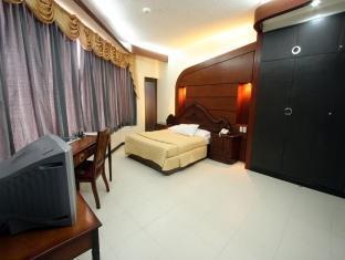 Sunflower Hotel Davao City - חדר שינה