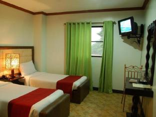 Ecoland Suites Davao City - Gästrum