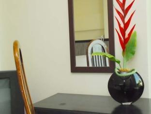 Panda Tea Garden Suites Tagbilaran City - Quartos