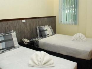 Panda Tea Garden Suites grad Tagbilaran  - Gostinjska soba