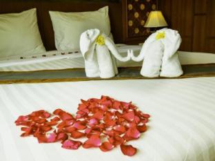 Renoir Boutique Hotel Phuket - soba za goste