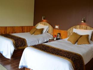 /lt-lt/tigerland-safari-resort/hotel/chitwan-np.html?asq=rj2rF6WEj8aDjx46oEii1KafzyGzQOoHvdtGu%2bQTQQpW8pun%2fIMgF4eKHszSWQe3k%2frBhTGPmtaTWsnmUqKcNi62oGI%2brQ9kfXUR%2bMxtJIintbLU8yWEqWP9WecFwWsy