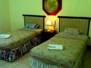 吉花园酒店 塔比拉兰市 - 客房