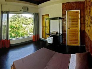 La Place Guesthouse Mactan Insel - Gästezimmer