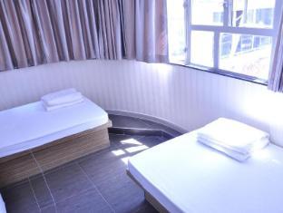 Jinhai Hotel Hong Kong - Kamar Tidur