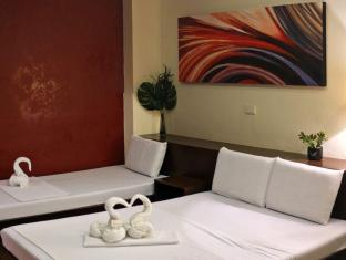 Palm Residence Inn Davao - Pokój gościnny