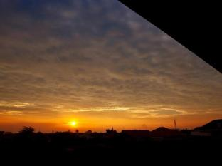 H.O.M.E Guest House Surabaya - Sunset view from rooftop terrace