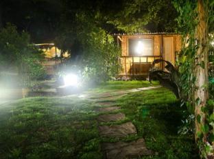 Samal Island Huts Davao City - Bahçe
