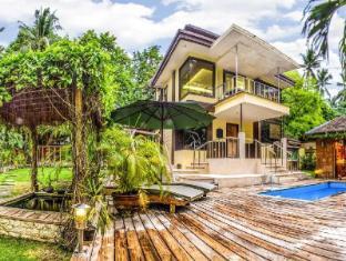Samal Island Huts Davao City - Otelin Dış Görünümü