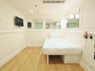 mini hotel Causeway Bay Hong Kong - Hotellihuone