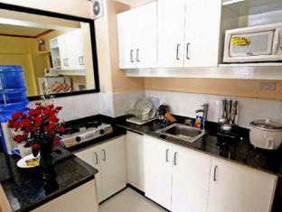 SDR Mactan Apartments Мактан Айленд - Вітальня