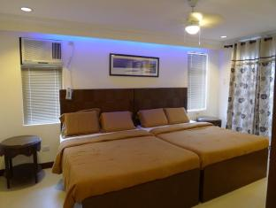 BlueFins Resort Mactan Island - Habitació