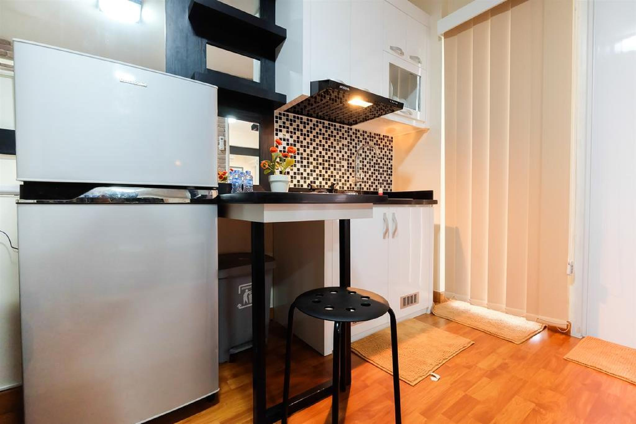 2BR Minimalist Bassura City Apartment By Travelio