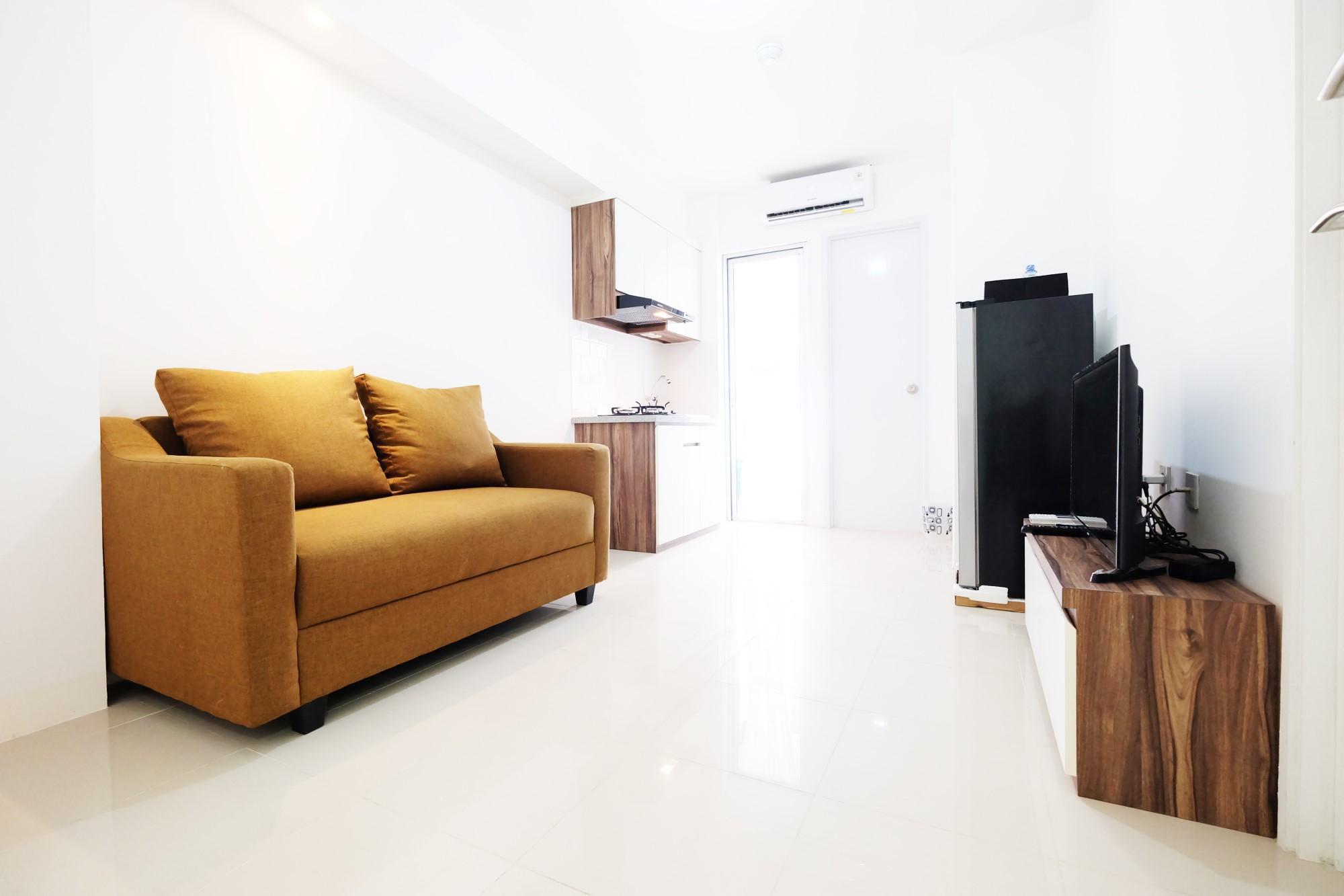 Comfy 2BR Bassura City Apartment By Travelio