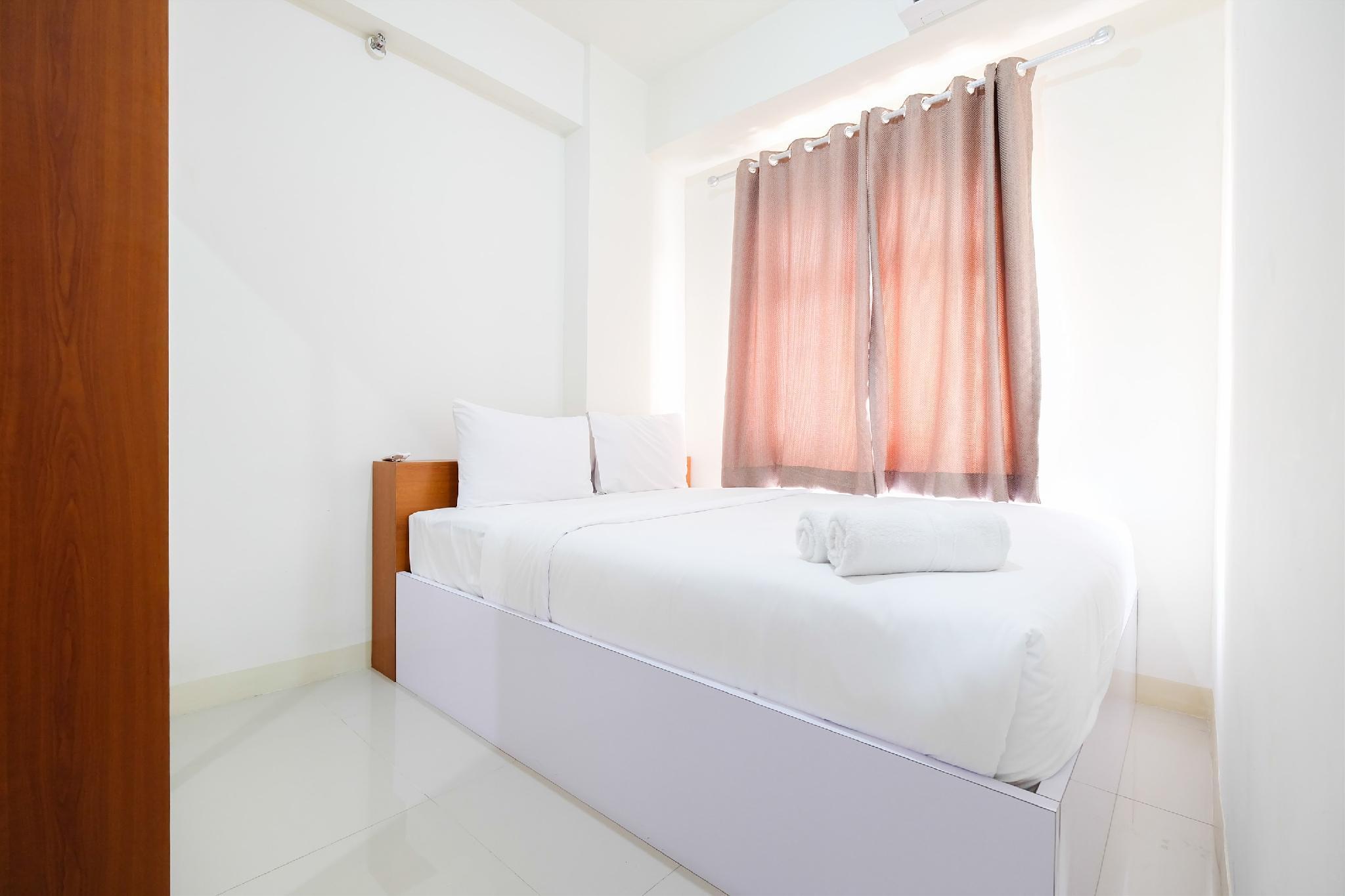 2BR Green Pramuka City Apt Mall Access By Travelio