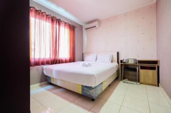 Modern 2BR at City Home Apt near MOI By Travelio Jakarta