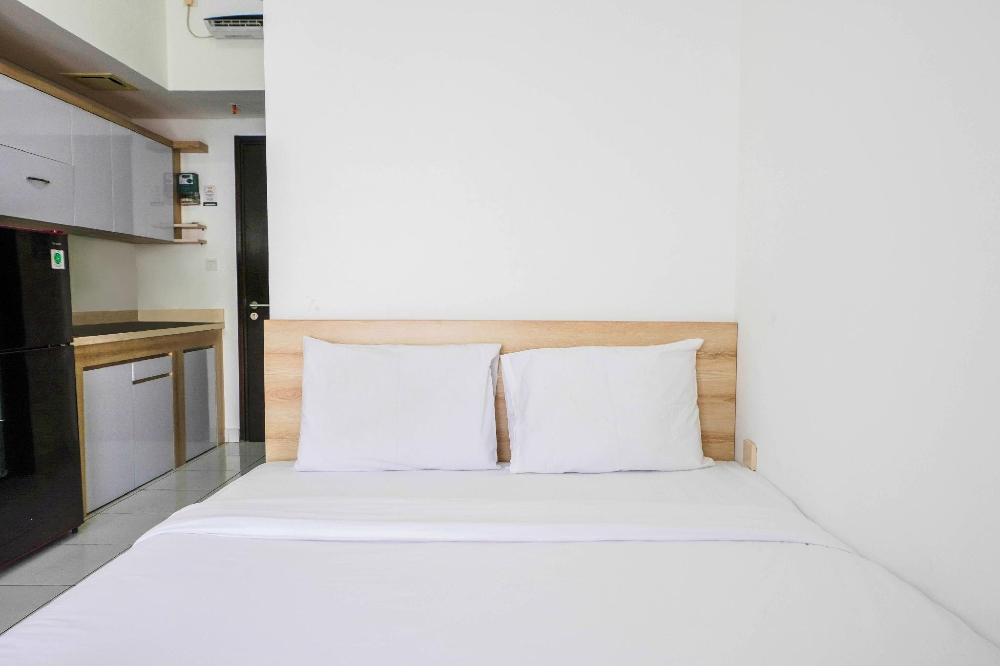 Homey Studio @ Casa De Parco Apartment By Travelio