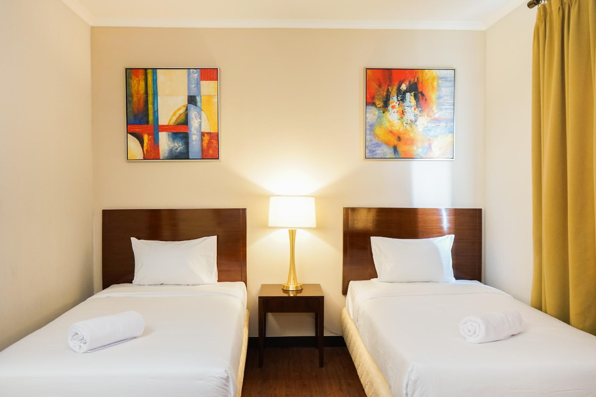 Enjoy Ancol Marina 1BR Twin Bed By Travelio