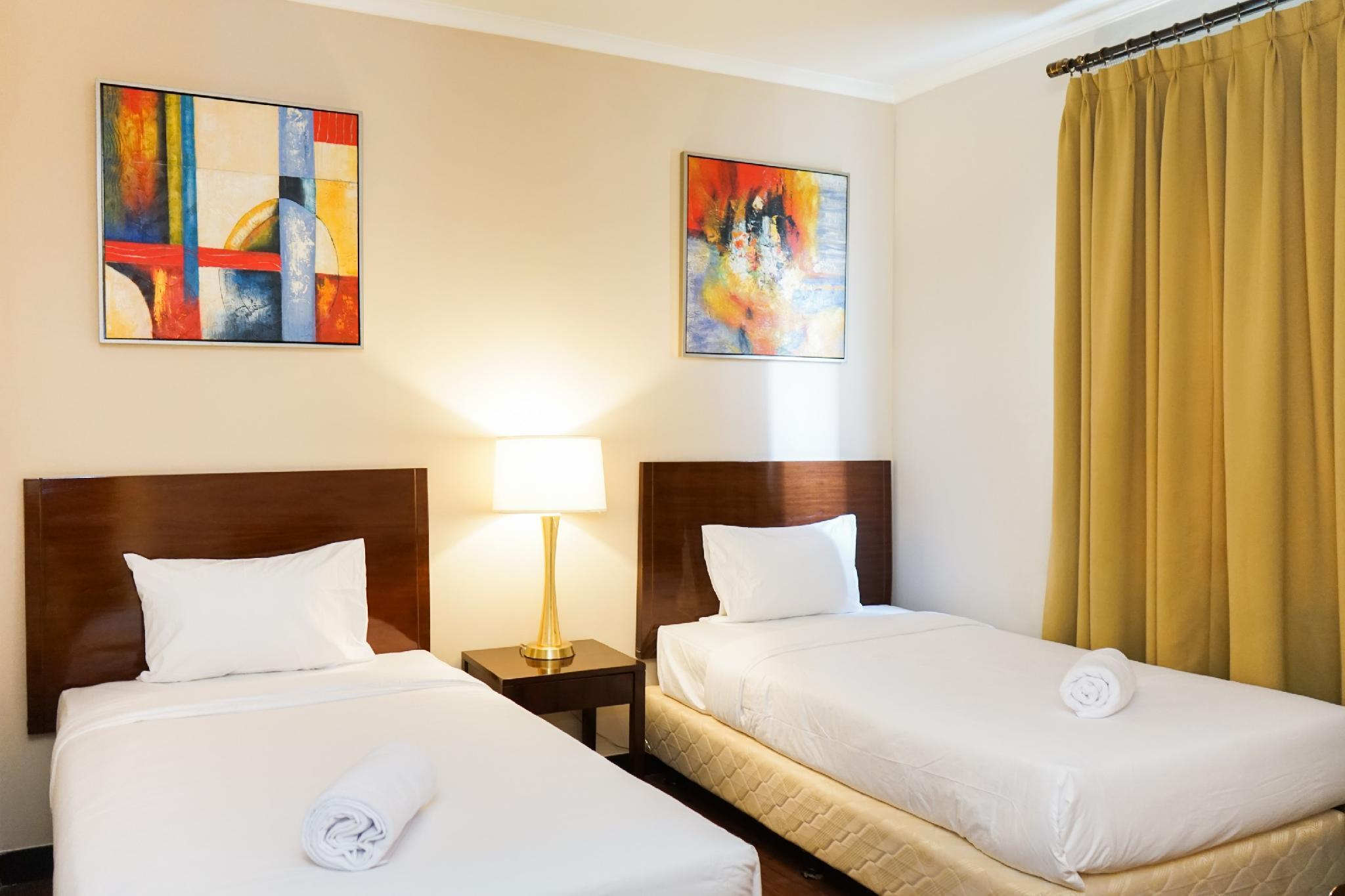 Comfy Ancol Marina 1BR Twin Bed By Travelio
