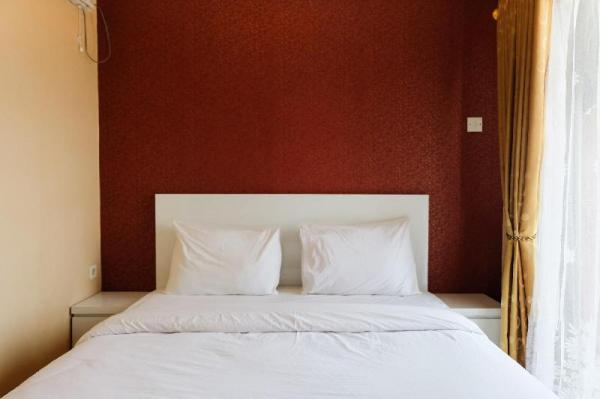Highest Value 2BR at Serpong Greenview Apartment By Travelio Tangerang